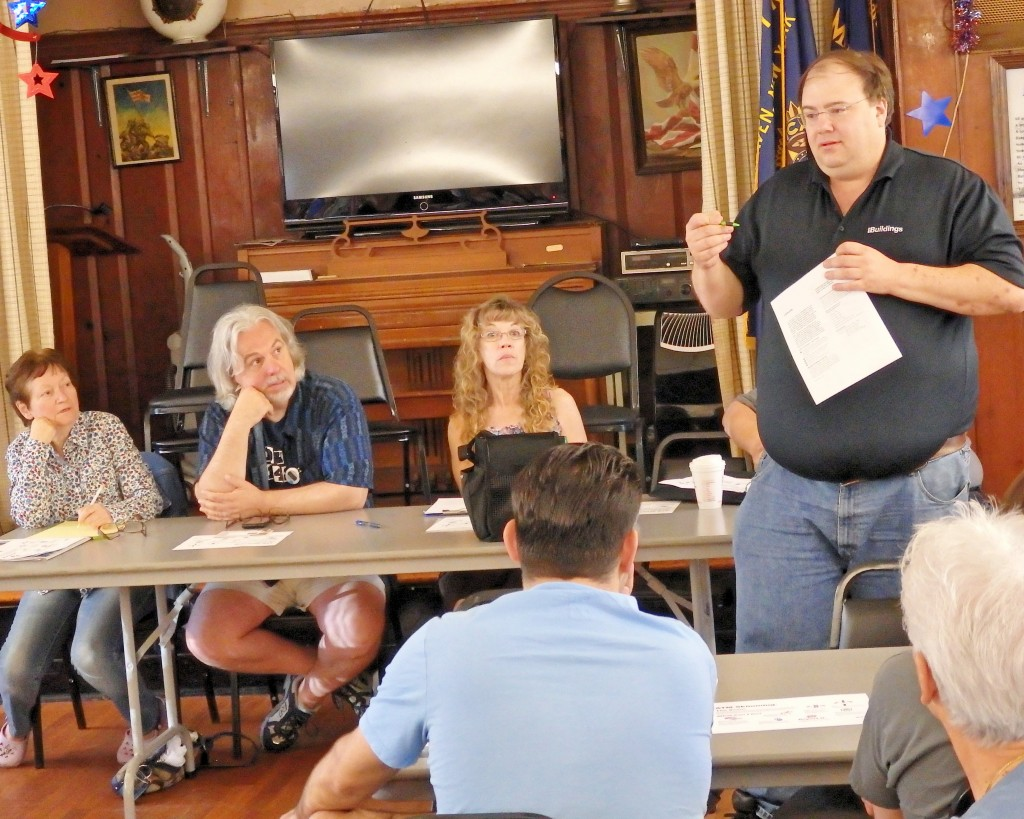 Buildings Department community liaison Kenneth Lazar (r.) addresses Woodhaven residents at a meeting over the weekend.  Photo by Phil Corso