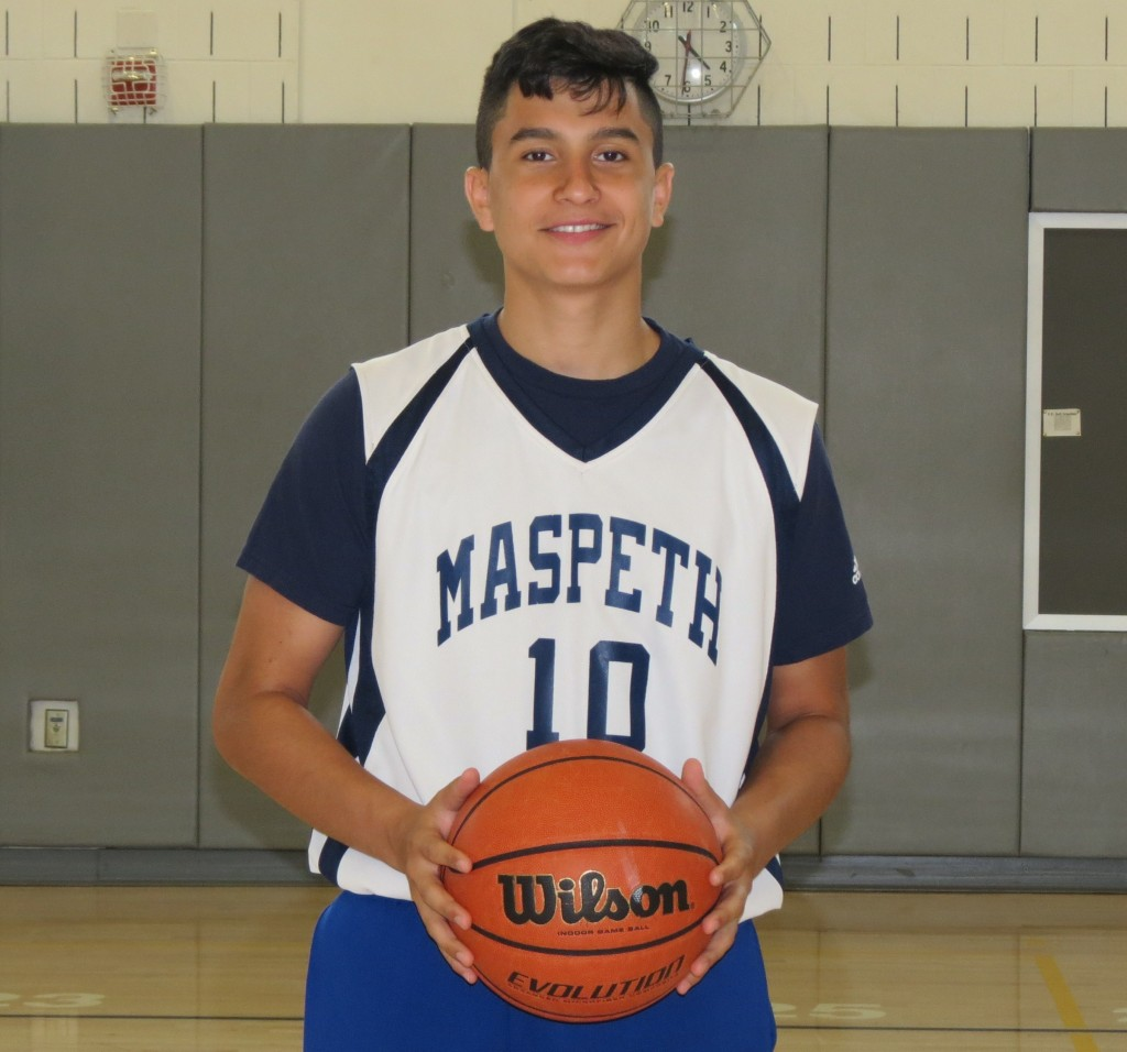 Paolo Tamer, Maspeth H.S. student/basketball athlete shows off his basketball on the school's basketball court.    Photo by Debbie Cohen