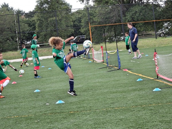 The soccer camp teaches kids of all skill levels how to handle the responsibilities of being a team player. Photo by Phil Corso