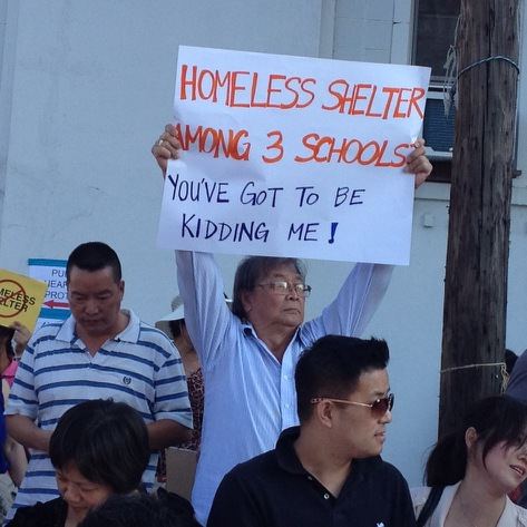 Crowds protest and hold up signs against homeless shelter.  Photo courtesy Geraldine Walsh