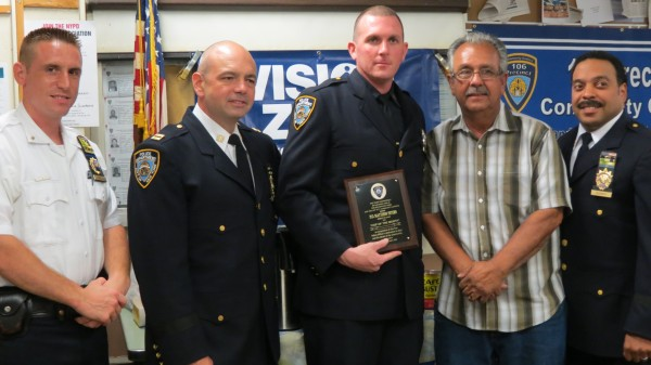[From left to right] Lieutenant Joseph Picarello, Officer John Ganley, Officer Matthew Peters, Community Council President Frank Dardani and Deputy Inspector Jeffrey Schiff present the cop of the month award to Peters at the 106th Precinct community council meeting on July 9. This is Peters' third time receiving the award. Photo by Ashley Helms