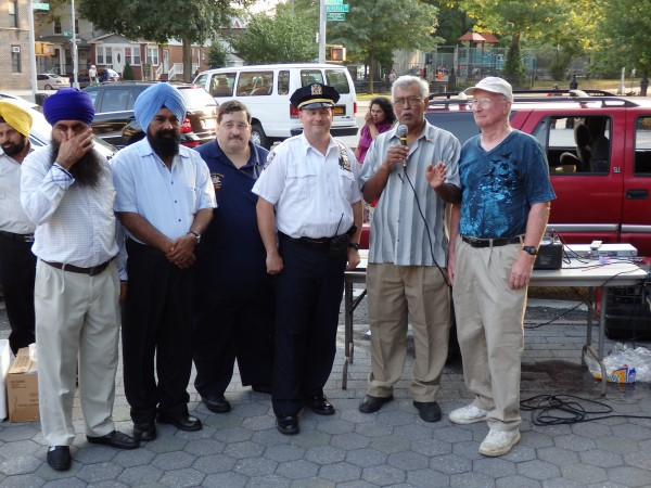 Members of the 102nd Precinct Community Council join with Deputy Inspector Henry Sautner for the National Night Out festivities.  Photo by Phil Corso.