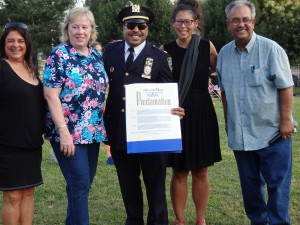 106th Precinct Deputy Inspector Jeffrey Schiff receives a proclamation from Mayor Bill de Blasio's office at the southern Queens precinct's National Night Out. Photo by Phil Corso