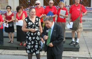 112th Precinct Community Council President Heidi Chain emcees part of her National Night Out festivities in Forest Hills alongside Queens District Attorney Richard Brown. Photo by Joseph Randazzao.