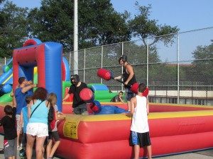 The central Queens 104th Precinct offers up plenty of fun for the whole family with inflatable rides serving as only one attraction at its National Night Out Against Crime on Tuesday.   Photo by Michael Florio