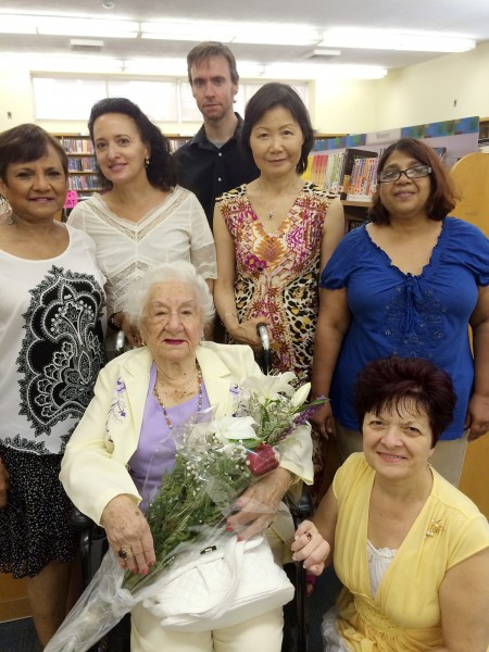 Sadie Rosenkrantz surrounded by her Queens Library friends:  Bibi Khan, Marjorie Khettab, Jason Reddy, Hwai Min Wood, Nazima Mohammed and Andria Amarosa Photos courtesy Queens Library