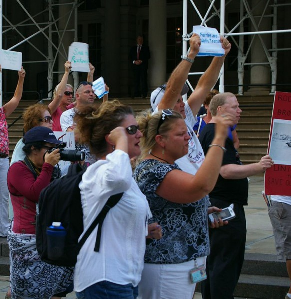 Demonstrators converge on City Hall demanding the mayor keeps ferry service running in Rockaway. PHOTO CREDIT: Jamie Pisani