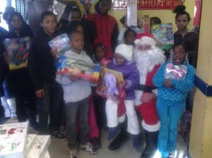 Children showing off their presents from Sandy Claus.    Photos courtesy Michael Sciaraffo