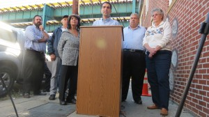 Councilman Eric Ulrich (at podium) is joined by civic leaders and business owners to announce the anti-graffiti initiative that has already begun in the 32nd Council District.  Photo by Michael V. Cusenza