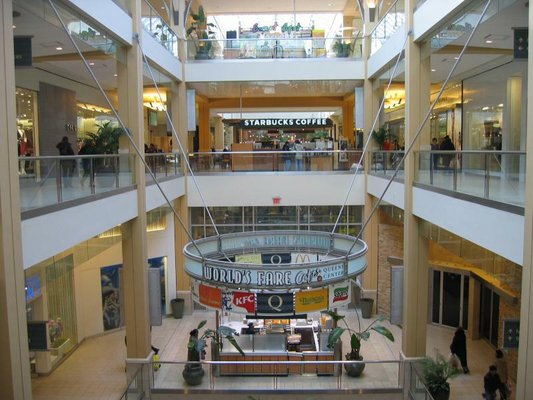 Simon Property Group has reportedly made a bid for Macerich, the company which operates both Queens Center (above) and the Shops at Atlas Park. Photo Courtesy of Yelp.