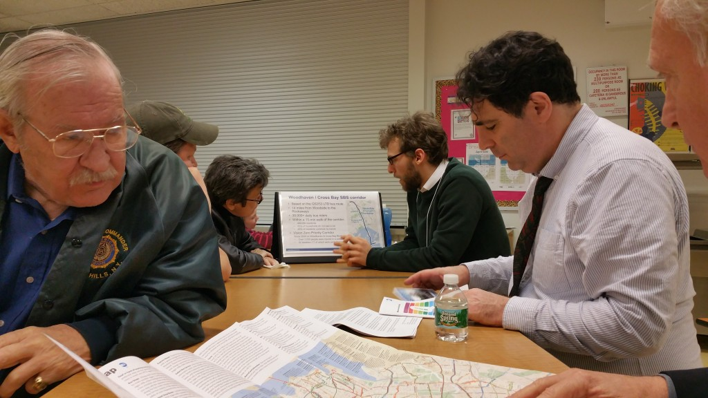 DOT representative Jeremy Safran (c.) details the Woodhaven-Cross Bay corridor Select Bus Service plan last Thursday at PS 316 in Ozone Park. Forum Photo by Michael V. Cusenza.