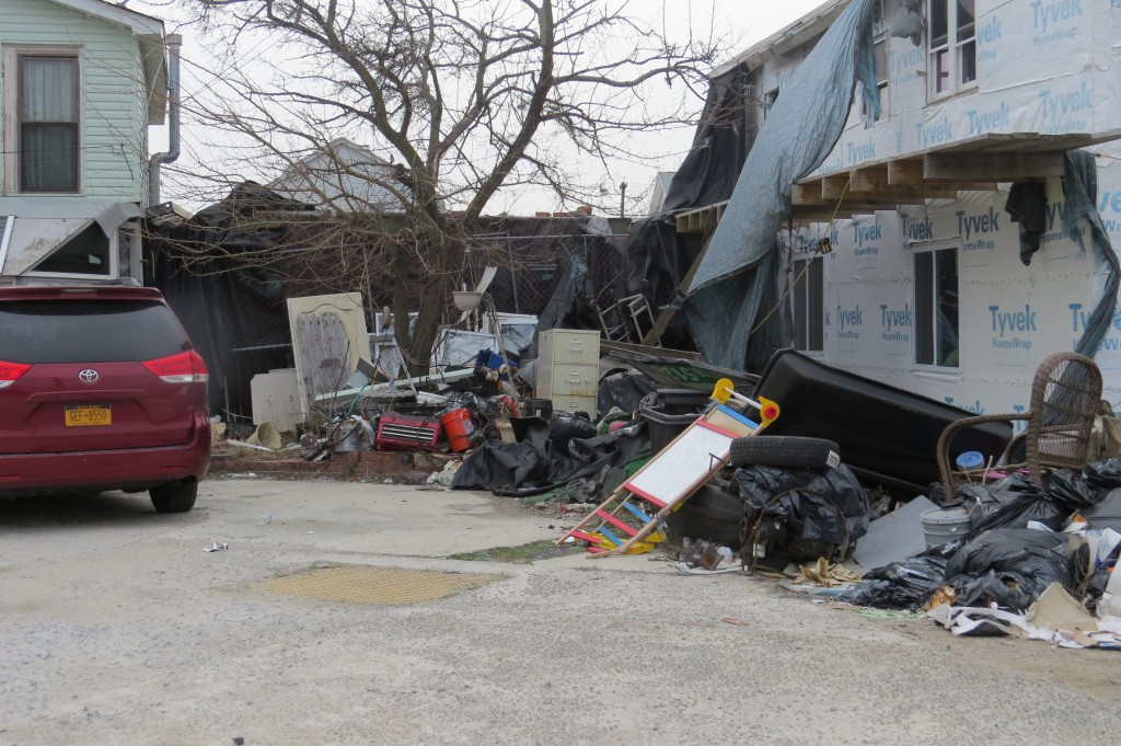 The boats are allegedly owned by the owner of this dilapidated, refuse-ridden residence in Hamilton Beach, a man who past is riddled with building code violations. Senator Joe Addabbo cautions that neglected properties can draw a variety of vermin and cause further damage to homes already in disrepair. Forum Photo by Patricia Adams.