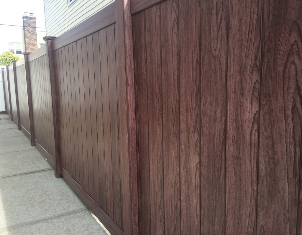 Among the beautiful new color choices available in vinyl fencing is an entire series of wood tones, including this rich walnut.