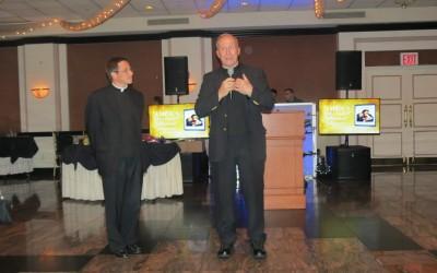 Msgr. Rucando Passes Shepherd's Staff to New OLG Pastor, Fr. Marc Swartvagher