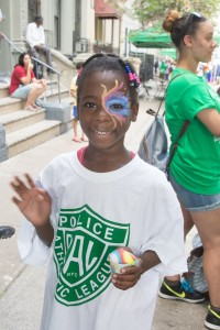 A girl shows off her face paint at a Police Athletic League Playstreets event. Photos Courtesy of Ben Asen