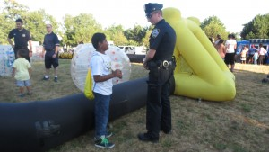 Cop chats up a prospective police officer on a warm evening in South Ozone Park.  Forum Photo by Michael V. Cusenza
