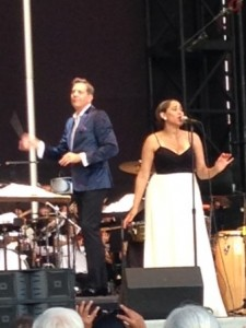 China Forbes, lead singer of Pink Martini, performs as Steven Reineke conducts the New York Pops orchestra at Forest Hills Stadium last week.  Forum Photo by Eugénie Bisulco
