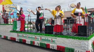 The Howard Beach Columbus Day Foundation, Inc. float had spectators dancing on the sidewalk.
