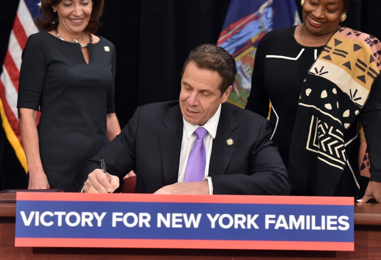 Cuomo 'Proud' to Sign Paid Family Leave Policy, Minimum Wage Hike into Law