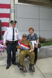 Capt. James Fey, commanding officer of the 106th Precinct, and parade Grand Marshal Edmund Puccio share a smile on Memorial Day. Forum Photo by Patricia Adams