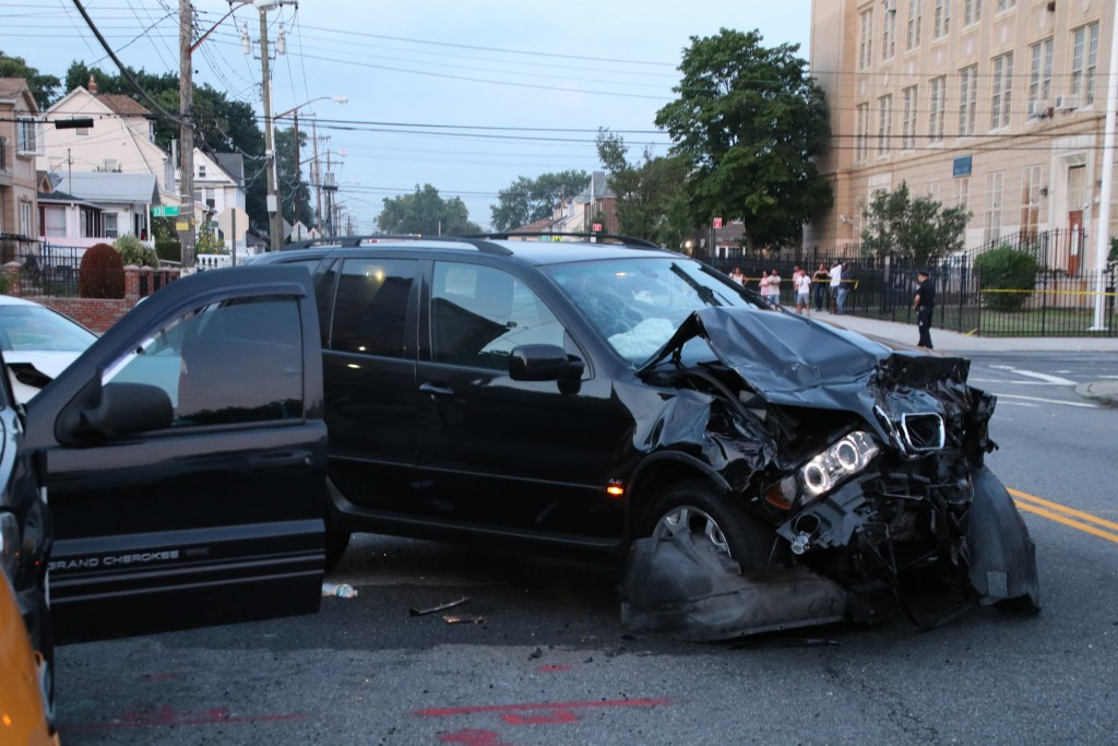 Police said the driver of the SUV blew by a stop sign and blasted the victims' vehicle at 115th Avenue and 130th Street in South Ozone Park.
