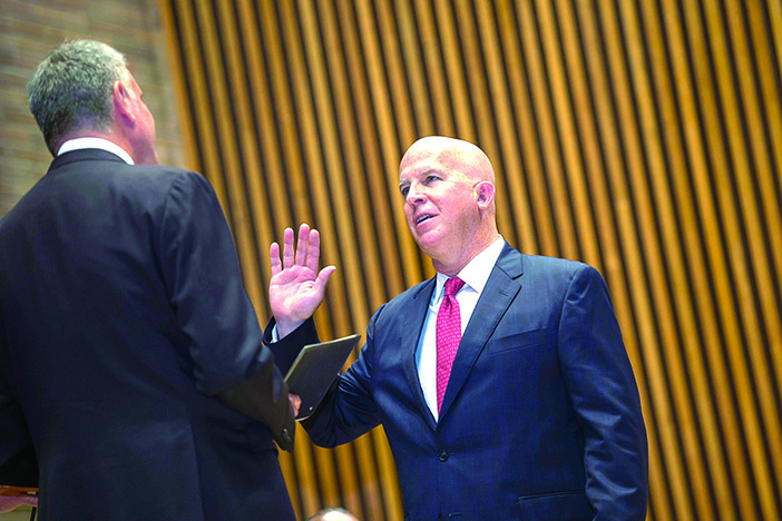 Career cop James O'Neill beams as he is sworn in as the City's 43rd Police commissioner.
