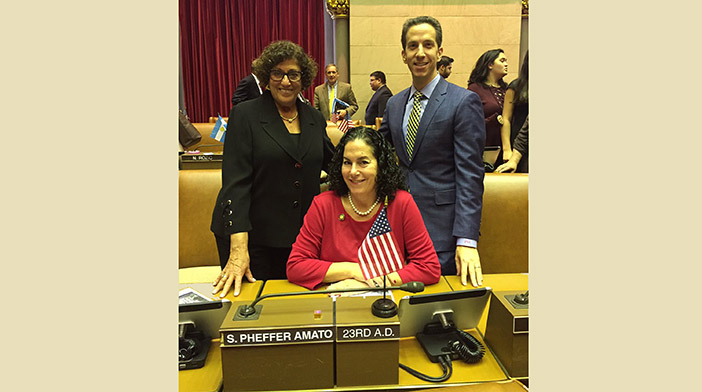 Mom and former Assemblywoman Audrey Pheffer, and Pheffer Amato's predecessor, Phil Goldfeder, welcome the freshman member to the Assembly chamber.