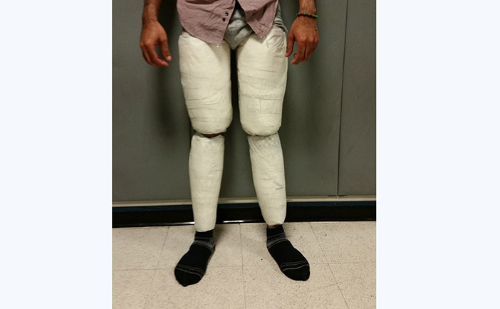 Customs Officers Catch JFK Passenger  with 10 Pounds of Coke Taped to his Legs
