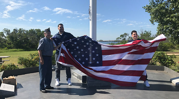 Two Howard Beach Cousins Replace old Charles Park Flag with Brand-New, Bigger Version