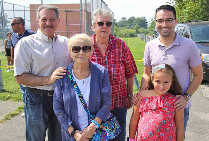 Photo Courtesy of Sen. Addabbo's Office Smiles abound Sunday as State Sen. Joe Addabbo, Jr., (back row, l. to r.); Community Board 10 Chairwoman Betty Braton; City Councilman Eric Ulrich; his daughter Lily; and his grandmother take in the 2019 Hamilton Beach Baby Parade.