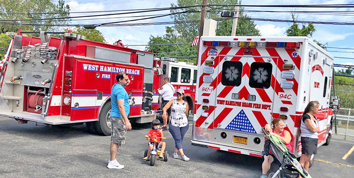 Photo Courtesy of Sen. Addabbo's Office The West Hamilton Beach Volunteer Fire Department rigs are a common sight at all Howard Beach community events.