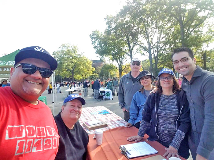 Photo Courtesy of Woodhaven Residents' Block Association The Fall Festival's sponsor, City Councilman Eric Ulrich (R-Ozone Park; far r.), visits with Martin Colberg (far l.) and members of the Woodhaven Residents' Block Association at Victory Field.