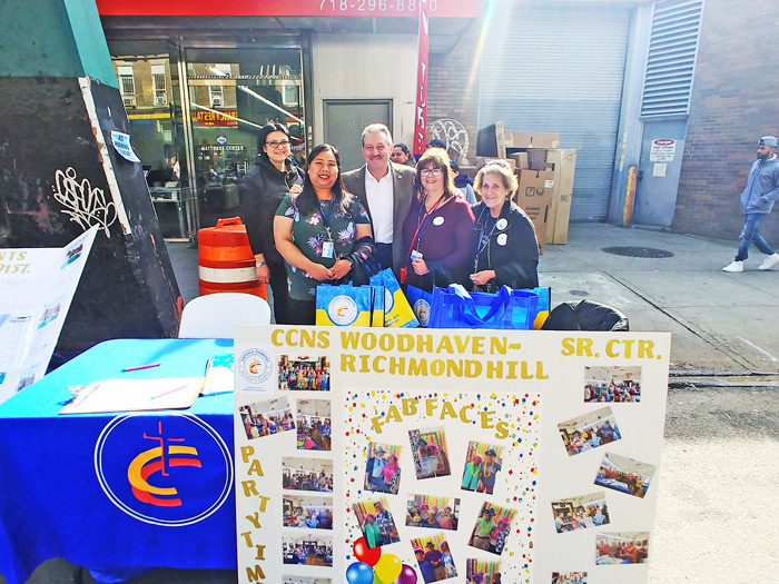 Photo Courtesy of Sen. Addabbo's Office State Sen. Joe Addabbo, Jr. (D-Howard Beach) is all smiles Sunday as he visits with staff members from the Catholic Charities Woodhaven-Richmond Hill Senior Center at the Wonderful Woodhaven Street Festival.
