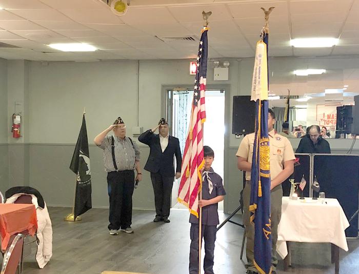 Scouts present colors.