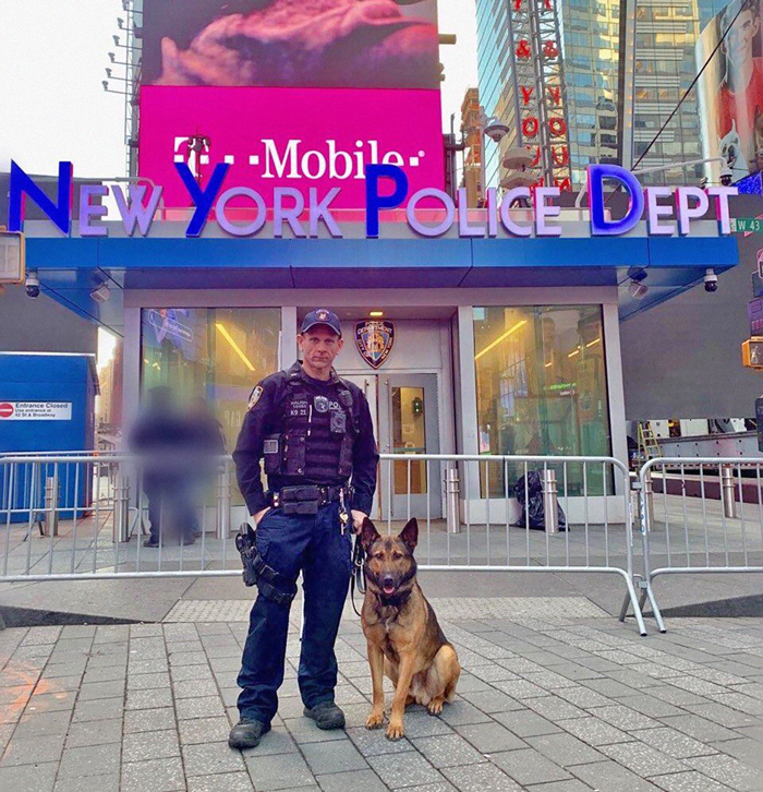 Photo Courtesy of NYPD NYPD Emergency Services Unit Officer Kalish and his partner, K9 Jimbo, who sniffed out the firearm.