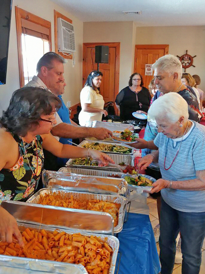 File Photo Addabbo serves food at a past BBQ.
