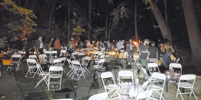 Photo Courtesy of NYC Sheriff On Oct. 11, deputy sheriffs shut down an illegal rave inside Cunningham Park in Fresh Meadows; more than 110 people, DJ, tables, chairs, bar, food service, hookah attendants, lighting, torches and security personnel.