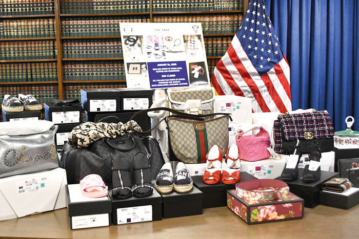 Photo Courtesy of DA Katz's Office  Using insider information, the defendants allegedly hauled tractor trailers loaded with more than $6 million worth of designer merchandise…