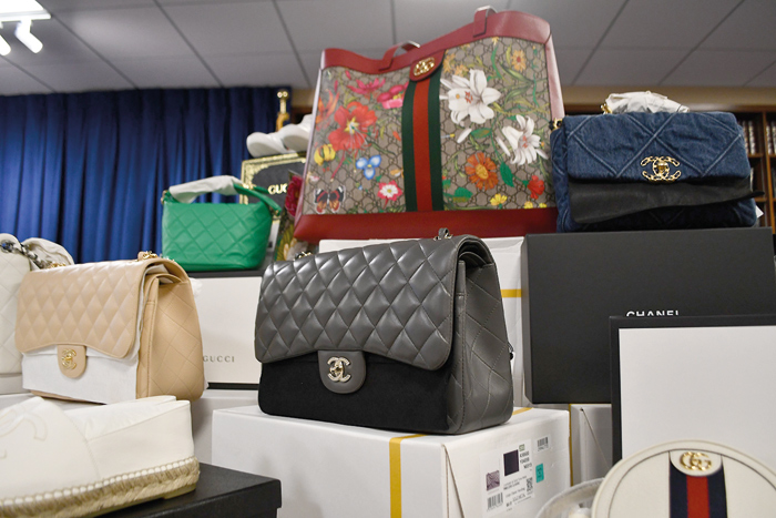 Photo Courtesy of DA Katz's Office … including Chanel handbags and jewelry, Gucci purses, sunglasses, sneakers and clothing, along with Prada bags, ready-to-wear and accessories.
