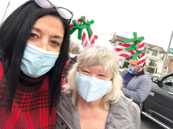 Civic President Joann Ariola and member Cathy Harrison are all smiles under those masks!