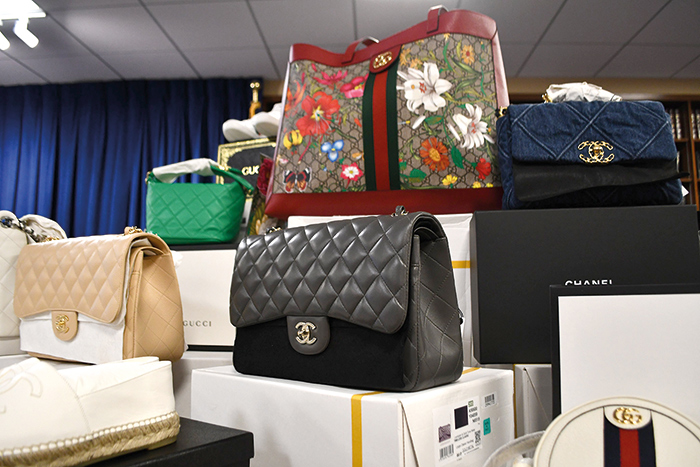 File Photo All but approximately $2.5 million worth of merchandise was sold. Police executing a court-authorized search warrant seized mountains of boxes stuffed with stolen Gucci bags, clothes and other accoutrements.
